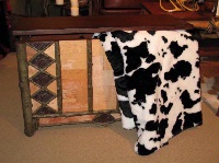 Denali® Western Collection: Black & White Cow Reverse Black Throw Blanket