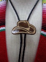 A Bolo Tie: Cowboy Hat Light on Dark Wood