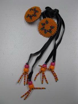 A Navajo Hair Tie: Beaded Rosettes of Orange with Green