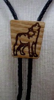 A Bolo Tie: Howling Wolf on Light Wood