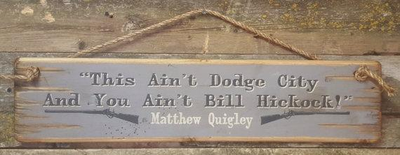 Wall Sign Movie Quote: Matthew Quigley. This Ain't Dodge City And You Ain't Bill Hickock