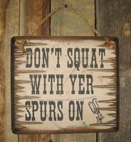 Wall Sign Advice: Don't Squat With Yer Spurs On