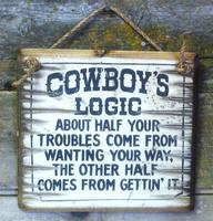 Wall Sign Advice: Cowboy's Logic About Half Your Troubles Come From Wanting Your Way...