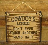 Wall Sign Advice: Cowboy's Logic Don't Ever Touch Another Man's Hat